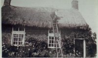 George Hutton thatching family home.